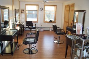 The salon has all new equipment and elegant wood furniture instead of
